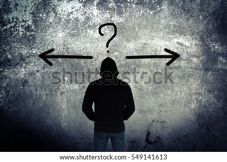 Lost,Man wearing hoodie looking to the wall with decision making concept and ideas