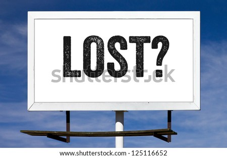Lost? message painted on a billboard sign