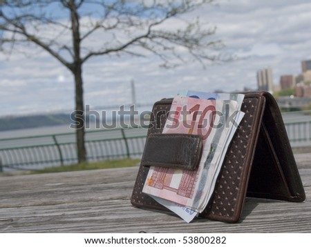 lost wallet with George Washington Bridge New York CIty in background