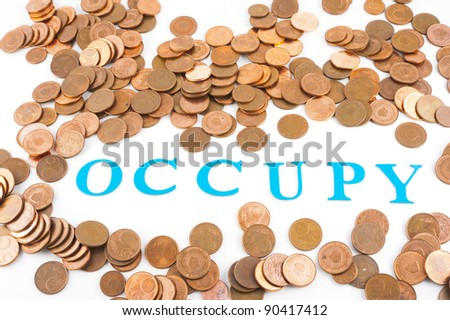 lot of coins and the word 'Occupy'