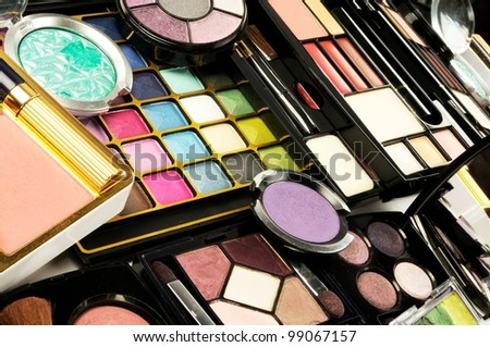 Lot of decorative colorful makeup sets , close up shot