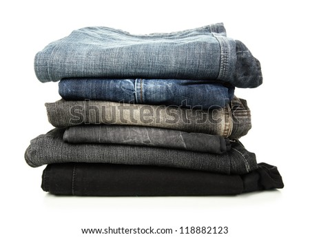 Lot of different jeans isolated on white