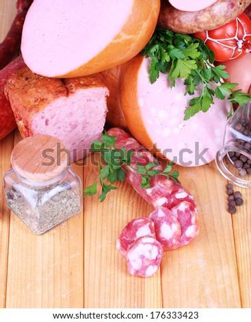Lot of different sausages on wooden table close-up