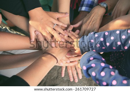 lot of hands together one over...
