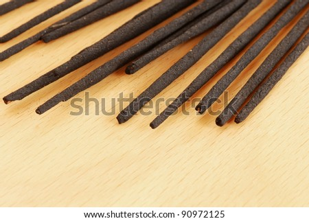 lot of incense sticks unlit on brown table