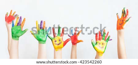 Lot of painted hands raised up. Group of multiracial funny children Funny kids hands up. World Conference for Well-being of Children in Geneva, Switzerland, June 1 Universal Children's Day 20 November