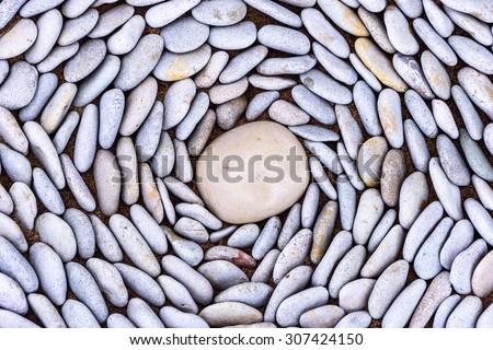 Lot of pebbles around big stone