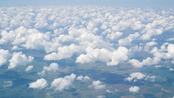 Lot of small sky from the plane. Small cute a lot of clouds in the sky, view from plane, bird eye view. Aerial view