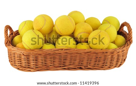 Lot of tennis balls in the basket isolated on white.