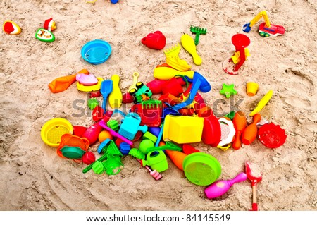 Lot of toys in the sand of a beach