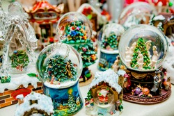 Lot of various snow globes on the table