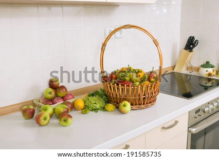 lot of vegetables and fruits on the kitchen table