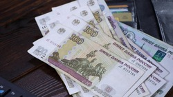 Lot with Russian rubles is on the wallet with credit cards.Paper banknotes Russian Rubles.Rubles is the national currency of Russia.bank of Russia.A thousand rubles close-up.Fall or rise of the ruble