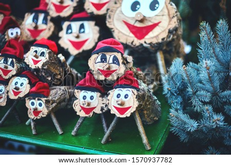 lots figures tio de nadal of close-up and blue spruce branches. Christmas character of catalonia, Christmas market in Barcelona. Zdjęcia stock ©