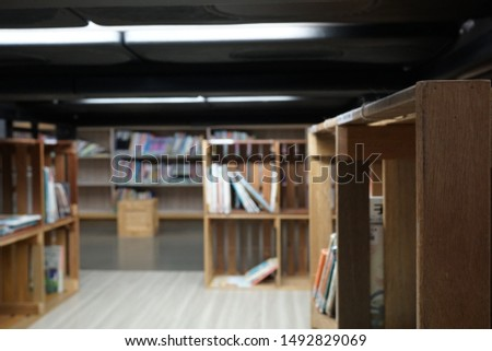 Lots of books and bookcases in the library. #1492829069
