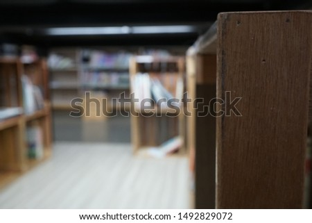 Lots of books and bookcases in the library. #1492829072