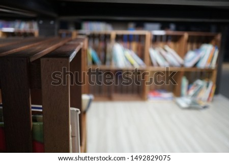 Lots of books and bookcases in the library. #1492829075
