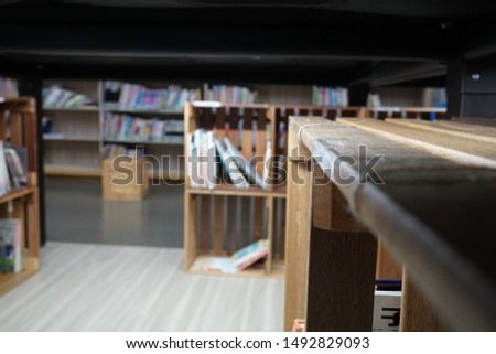Lots of books and bookcases in the library. #1492829093
