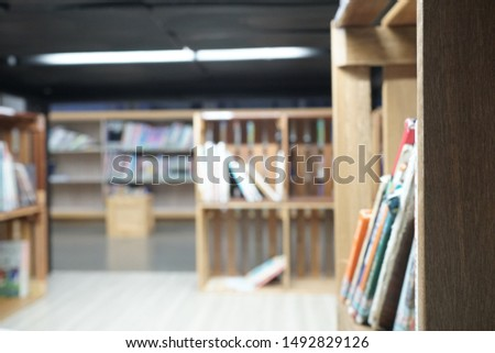 Lots of books and bookcases in the library. #1492829126