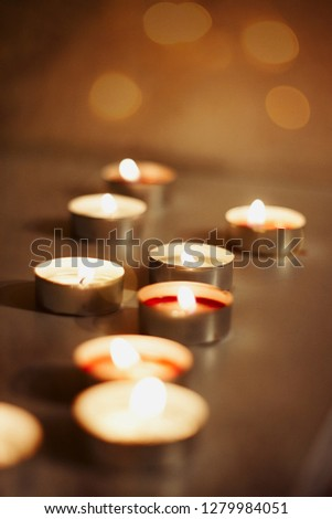lots of burning candles of different colors for a romantic atmosphere and relaxation  #1279984051