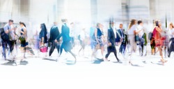Lots of business people walking in the City of London. Blurred image, wide panoramic view of the crossroad with people at sunny day. London, UK