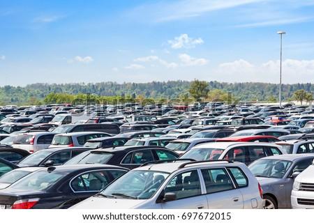 Lots of cars parking at airport carpark #697672015