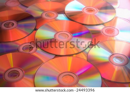 Lots of CD DVD disks in red light.