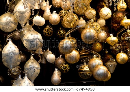 lots of Christmas ornaments and Christmas balls on the market before the Town Hall in Vienna