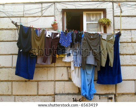 Lots of clothes drying at the window