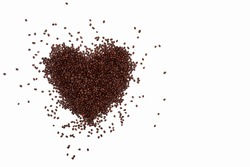 lots of coffee beans scattered in a heart shape on a white background. fried brown coffee beans are scattered on the surface, lovers of coffee drinks, love of coffee
