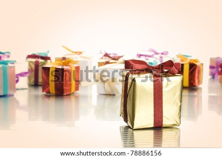 Lots of colorful gift boxes tied with ribbons. A gift for Christmas, Birthday, Wedding, or Valentine's day