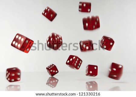 lots of dice fulling and rolling shot in the studio on  white background