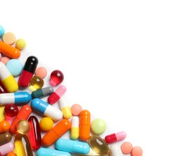 Lots of different colorful pills isolated on white, top view