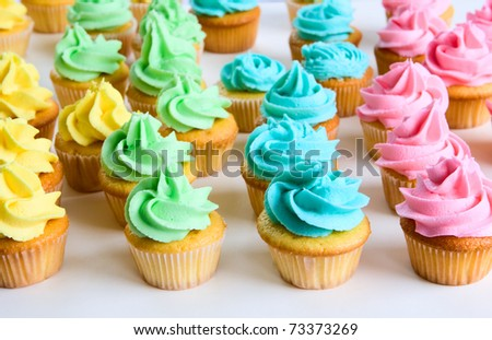 lots of fancy rainbow cupcakes