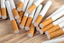 Lots of industrial cigarettes close up, cigarettes.