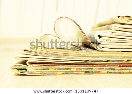Lots of Newspaper Pages Stacked in Pile. Stack of Magazines and Journal, Side View                    #1501109747
