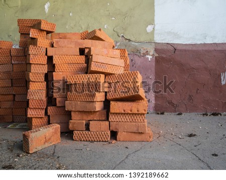 Lots of old bricks piled up. Wall of different colors. Construction atmosphere. Texture, background #1392189662