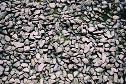 Lots of pebbles pattern as background. Monotone color.