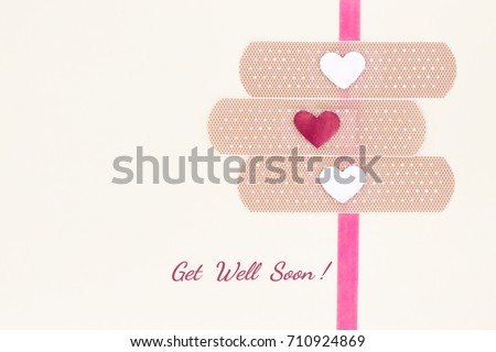 Lots of possibilities with get well soon bandages card on yellow cream background.Colorful and bring a smile to anyone face.Top view and flat lay. #710924869
