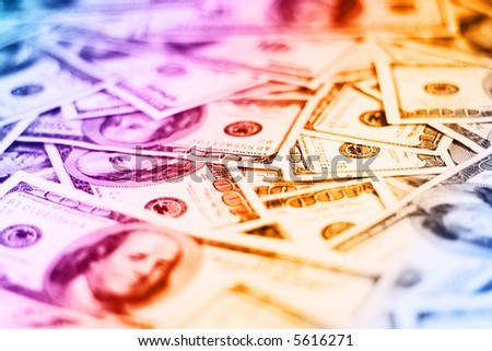 lots of real 100 colourful greenbacks for background (shallow dof)
