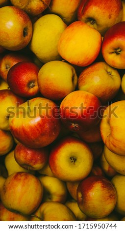 lots of red and green apples. A lot of colorful fresh red apples. Red and yellow apples,apples,Apple. Fresh green and red apples background. Top view. Fruits on market. vintage photo processing