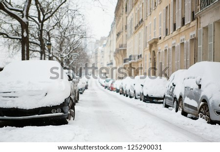 Lots of snow in Paris. Cars covered with snow