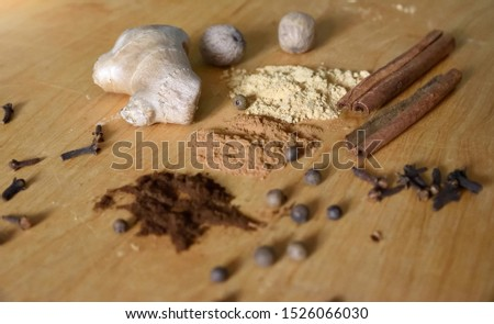 Lots of spices on wooden background and with mortar  and spice, spice preparation concept