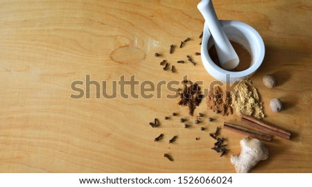 Lots of spices on wooden background and with mortar  and spice, spice preparation concept, banner background with copyspace