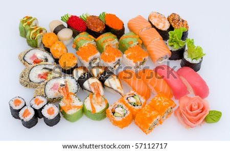 lots of various Japanese sushi and sushi rolls