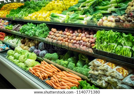 Lots of Vegetables in the Produce aisle at a Supermarket