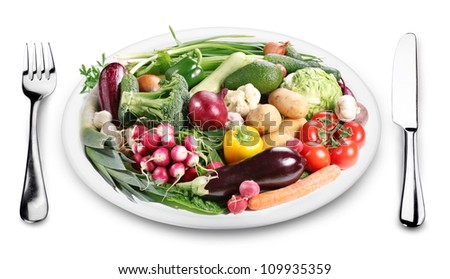 Lots of vegetables on a plate. Image on white background. - stock photo