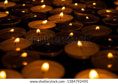 Lots of wax tea candles burning. Illustration of a romantic, gentle, seductive. erotic evening. Possibly even mystical.  #1384792490