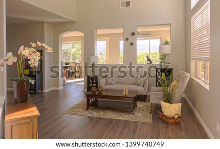 Lots of windows and an open floorpan make for light and bright living spaces in a remodeled home #1399740749