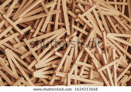 Lots of wooden phone stands piled in a pile.